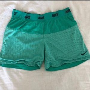 Green nike shorts